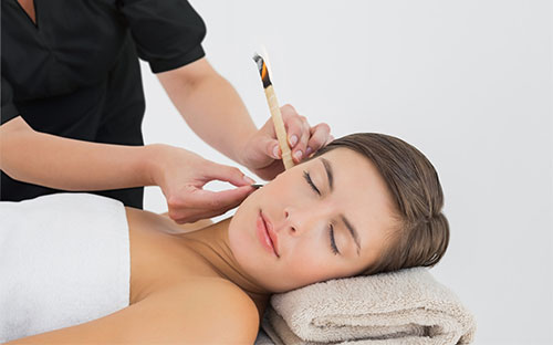 Women receiving an Ear Candling
